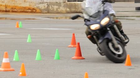 autobike : Lipetsk, Russian Federation - September 17, 2016: Competition the Moto gymkhana, motorcycle maneuvering between the cones Stock Footage