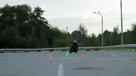 autobike : Lipetsk, Russian Federation - September 17, 2016: Competition the Moto gymkhana, Motorcyclist rides between the cones in a special area Stock Footage