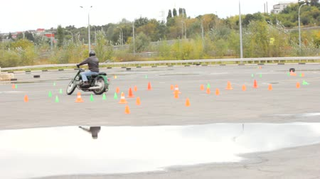 autobike : Lipetsk, Russian Federation - September 17, 2016: Competition the Moto gymkhana, rider on an old motorcycle passing the route of the road cones
