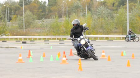 autobike : Lipetsk, Russian Federation - September 17, 2016: Competition the Moto gymkhana, Motorcycle events, motorcycle rider at speed runs a line of road cones Stock Footage