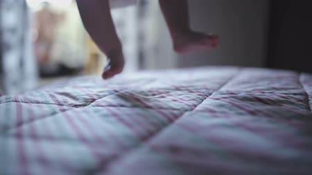 nascido : Parents playing with baby on the bed Stock Footage