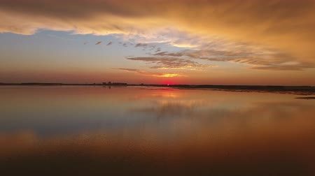 pantanal : very beautiful reflection of the sunset in a swamp in India