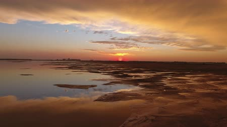 cisza : very beautiful reflection of the sunset in a swamp in India