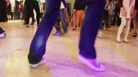teen action : Dancing feet adults and children at the childrens birthday partyDancing feet adults and children at the childrens birthday party Stock Footage
