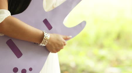 serseri : Newly married couple play lined lilac guitars. Five plans. Stok Video