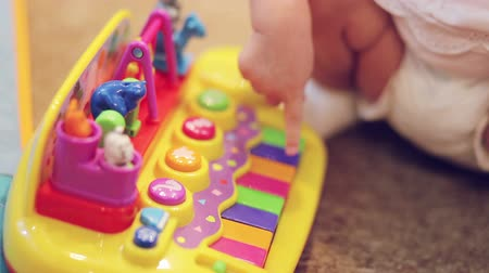 piano parts : Child playing on a plastic toy piano Stock Footage