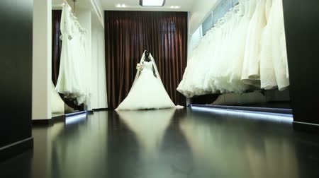 подвенечное платье : Series of luxury wedding dresses and a dress on a mannequin. Dolly shot.