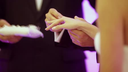 ring : Groom puts the ring on your finger marriage bride.