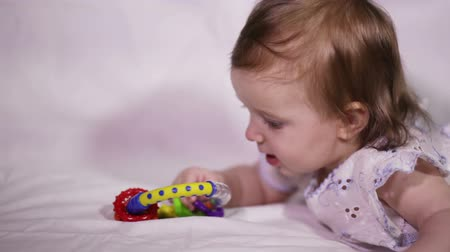 kisbaba : Mommy gives the child a colorful baby rattle