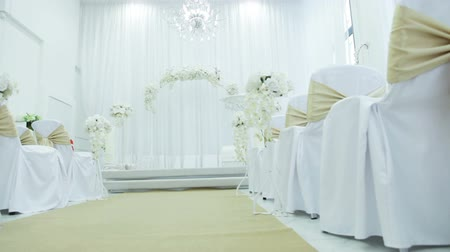 setting : Festively decorated hall for wedding ceremony
