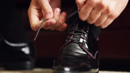 calçados : Close-up of tying the laces on expensive shoes