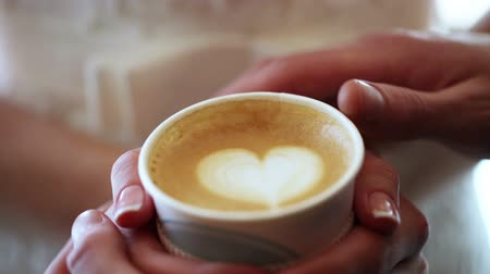 coffe : Hands of bride and groom holding a cup of coffee Stock Footage