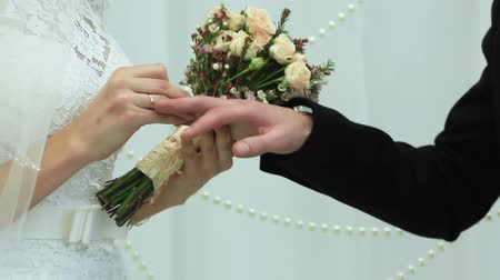 weddings : Two white people groom and bride exchange wedding rings