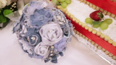 wedding cake : Camera flies over cake and a wedding bouquet