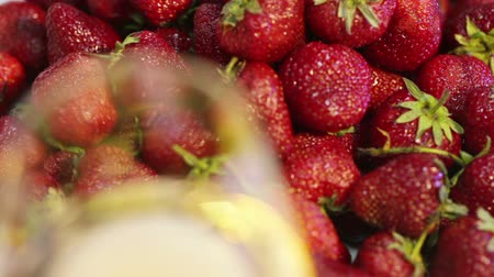 içme : Festive buffet with ripe strawberries and sparkling champagne
