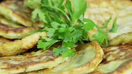 оладья : Rotating fritters decorated with parsley