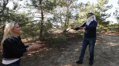 gizleme : In coniferous forest blindfolded guy chasing girl Stok Video