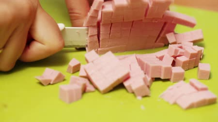 emmental : On plastic chalkboard girl with manicure knife cut boiled sausage Stock Footage