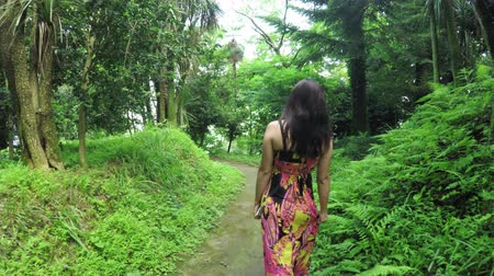 сады : In botanical park girl walking. Botanical Garden Batumi, Georgia