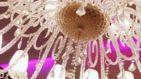 żyrandol : Camera is rotated by large luxury crystal chandelier