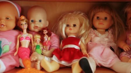 raf : Several dolls on shelf
