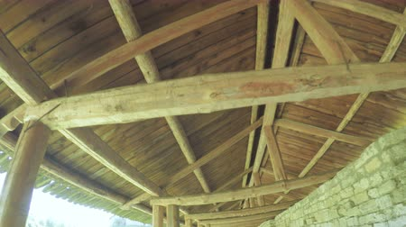 wall building feature : Wooden carport on wall Stock Footage
