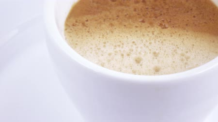 side view : White cup with coffee Stock Footage