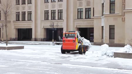 snow plow : Snow cleaning tractor Stock Footage