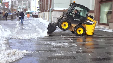 after the storm : Snow cleaning tractor Stock Footage