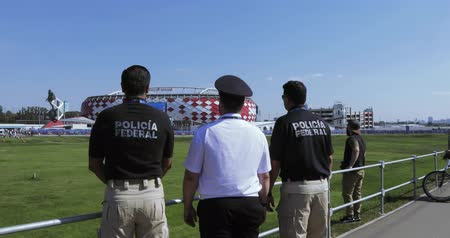 crowd together : Mexican policemen with fans