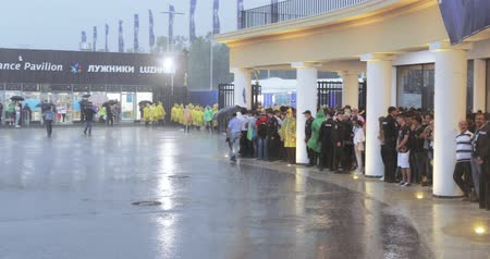 steward : Football fans under the shower after the completion of the stadium