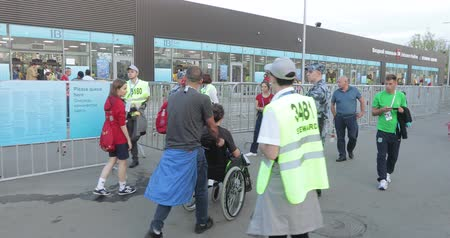 crowd together : Disabled fan and accompanying people