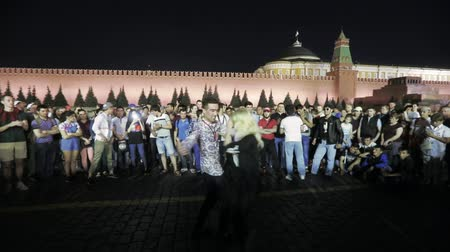 multinational : Football fans dance on Red Square