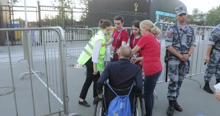 Disabled fan and accompanying people