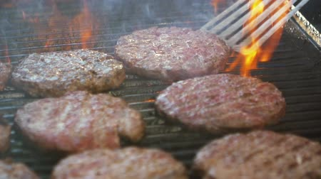 bbq grill : SLOW MOTION: burgers at the grill with fire and smoke