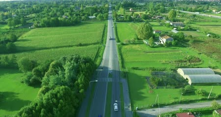 управлять : Aerial shot Typical countryside in Europe, roadway, houses, lots of beautiful forests and fields around, top view