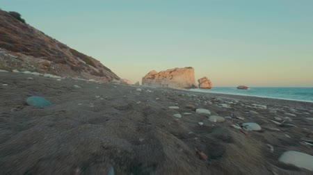 levee : POV Walk along the coastline of the ocean, sea on the sandy beach at sunset. Amazing seascape