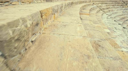 gladiatorial : POV shot Kourion Cyprus Theatre. Walking tour in Kourion ancient Greek amphitheater ruins