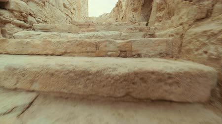 gladiatorial : Rapidly rise the steps of the ancient ruined city POV. Corridors and stairs of ancient building Stock Footage