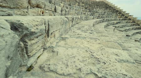 gladiatorial : Tracking shot Moving up the steps of an ancient amphitheater Kourion Cyprus Theatre