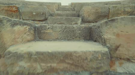 gladiatorial : Reverse movement Climbing up, down the stairs of the amphitheater in a Kourion Cyprus Theatre. POV