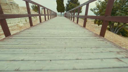 gladiatorial : Walk along the bridge to sea in an ancient historical place Cyprus, Greece. POV shot