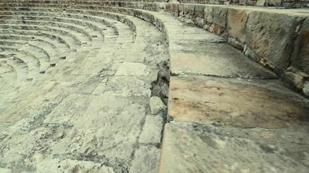 gladiatorial : Descent down the stairs of the ancient amphitheater of Kourion Cyprus Theater. Tracking shot