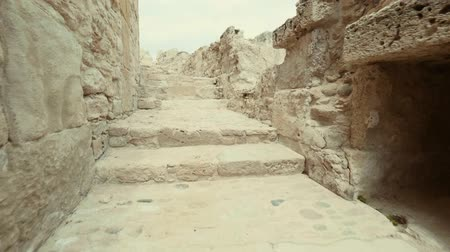 gladiatorial : POV Climbing up the stairs in ancient city-state. Walk in corridors and staircases made of stone
