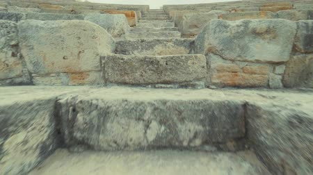 gladiatorial : Climbing up the stairs of the amphitheater in a historical ancient place Kourion Cyprus Theatre. POV Stock Footage