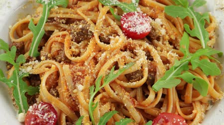 dish : Spaghetti Bolognese with cherry tomatoes and arugula Stock Footage