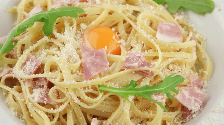 dish : Italian pasta Carbonara with parmesan, yolk and bacon