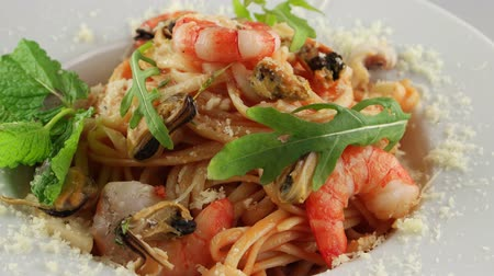 dish : Pasta with shrimps, mussels, squid and parmesan cheese