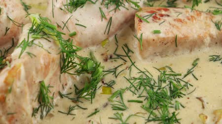 kalakeitto : Fish soup with salmon, cream and parsley in a frying pan Stock Footage