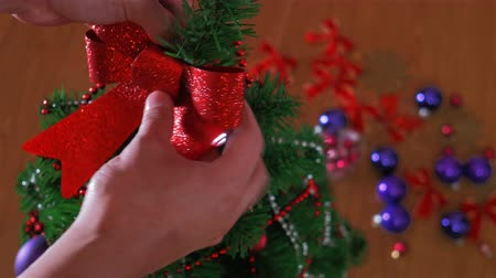 Mans hand decorating christmas tree